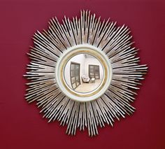 """Hobbs Mirror  An exceptional sunburst mirror with individually carved sunrays and an eglomisé center.    Dia 39"""" approx. / Center: Dia 12"""""""