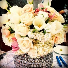 Centerpiece. #roses #tulips #orchids #flowers #crystals #weddings #decor #hydrangeas #pink #white