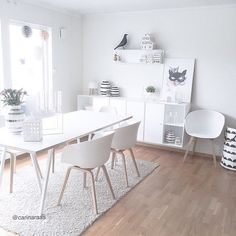 """I love this white on white dining area, especially the buffet for extra storage with shelving above (oh and the chairs ) @carinaraas  
