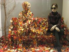 LOVE. THIS. - talk about a window with wow!   PS. - good way to use a distressed mannequin, cover it with leaves!