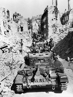 A picture taken in August 1944 during World War II shows Allied troops entering the Nazi-held largely destroyed French city of Falaise, in Normandy.