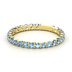 Kile's birthstone to stack with my wedding rings.  14K Yellow Gold Ring with Blue Topaz - lay_down