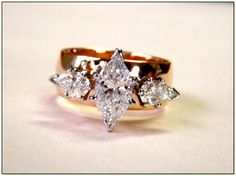 Vintage 3 diamond ring - Marquise canter, 2 pear side. 14k yellow gold