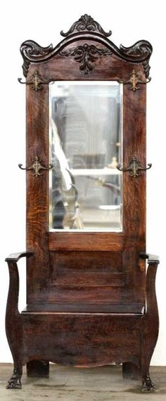Antique Hall Tree With Beveled Glass Mirror Surrounded By Hat And Coat Racks, Bottom Bench Opens