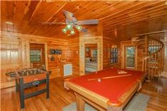 Many of the Smoky Mountain cabins we offer have game rooms! Grand View Lodge features a foosball table, pool table, ping pong table and electronic dart board!