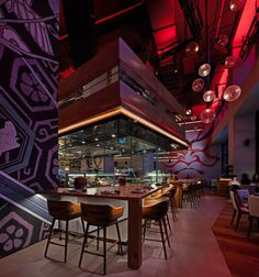 "Tasca and Netsu Restaurants at the Mandarin Oriental Jumeira, Dubai - dpa lighting consultants - ""Right Light, Right Place, Right Time"" ™ #dpalighting #lightingdesign #restaurantlighting #barlighting #pendants #concealedlight #uplighting #redlight #warmlight #undercounterlighting #spotlights"