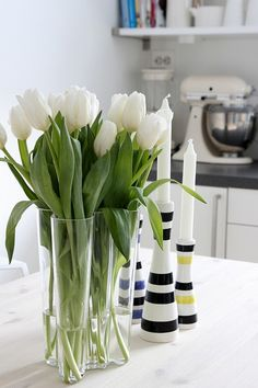 I love white tulips. I must find a vase like this!