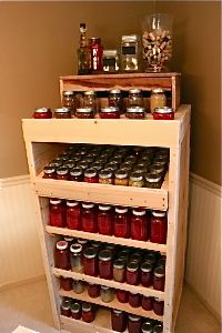 Homestead Revival.com easy storage for canning, with slight slant on shelves so when you take a jar out another gently slides forward. Store 250 jars. awesome!!