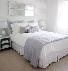 grey and white bedding. Also love mirrors on wall above bed, and simple bedside table