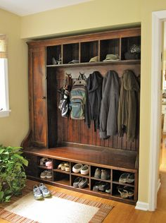 This is a custom mudroom rack made of New England Barnwood. It is not built in and is a freestanding piece of furniture. There are shelves behind the door and 2 removable tool boxes on the bottom left. It can me made to order in any size and finish. It can be made of old wood and new wood by Country Willow, Bedford Hills, NY - 914-241-7000  -  www.countrywillow.com