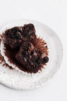 Easy Double Chocolate Muffins | Satisfy all of your chocolate cravings with these easy double chocolate muffins that come together in minutes. This no fuss muffin recipe can be made without a mixer and makes the perfect indulgence any day of the week.