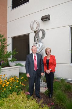 Tuesday, June 25, 2013-First Community Bank Business After Hours: Boris Dover and Dianne Lamberth pose in front of the John Ellis sculpture dedicated to them by First Community Bank for their service to the White River Health System Board of Directors and the community.