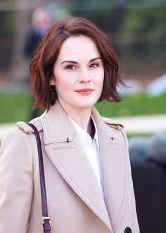 Michelle Dockery. Love the short cut and flawless skin.