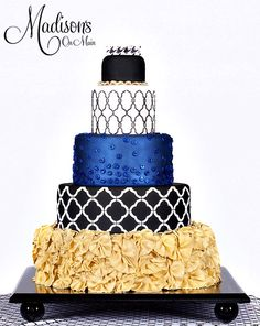 Blue and gold ruffle wedding cake with black and white quatrefoil and houndstooth geometrics