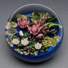 Cathy Richardson Make no mistake, this is a larger than normal weight with an entire lily pond's worth of flowers and greenery inside. Different Kinds Of Art, Lily Pond, Vanity Decor, Hood Ornaments, Glass Marbles, Venetian Glass, Glass Paperweights, Glass Ball, Paper Weights