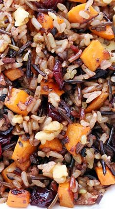 I'd switch out the walnuts for pecans >> Cranberry, Walnut & Sweet Potato Wild Rice Pilaf. Very good stuff. I roasted butternut squash and sweet potatoes for this. Be sure to slightly undercook next time so they're not mushy. Couscous, Vegetarian Recipes, Cooking Recipes, Healthy Recipes, Quinoa, Wild Rice Recipes, Vegan Sweet Potato Recipes, Sweet Potato Rice, Wild Rice Pilaf