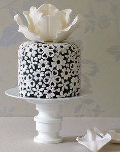 Very beautiful black and white cake! look close at this design I see hearts. Nice.
