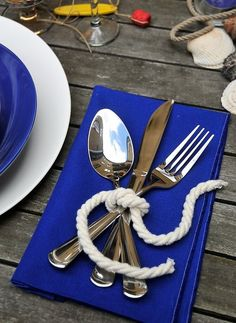 Silverware tied with rope for a nautical place setting. Nautical and beach themed weddings catered by Foster's Premium Catering, York, Maine. http://www.fosterspremium.com. Fosters Clambakes and Catering authentic New England lobster and clambakes.