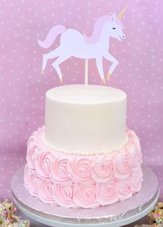 Pink rosette unicorn cake from a Pastel Unicorn Themed Birthday Party via Kara's Party Ideas | KarasPartyIdeas.com (15)