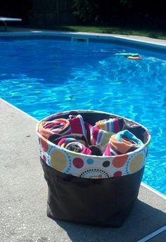 Thirty one bin makes a great poolside caddy.  www.mythirtyone.com/mrbryant