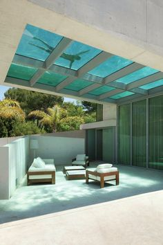 Patio shaded by the cantilevered swimming pool. Jellyfish House in Marbella, Spain by Wiel Arets Architects.