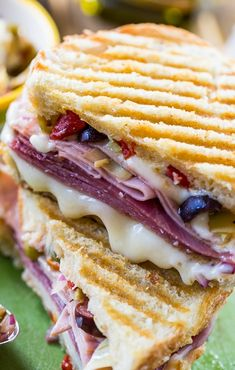 Panini with 3 types of meat, provolone cheese, and olive relish.Muffaletta Panini with 3 types of meat, provolone cheese, and olive relish. Panini Sandwiches, Grilled Sandwich, Best Sandwich, Soup And Sandwich, Wrap Sandwiches, Muffuletta Sandwich, Vegetarian Sandwiches, Bruschetta, Crostini
