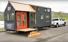 The Kootenay: a 204 sq ft tiny house with a burnt cypress exterior from Tru Form Tiny Homes. The home was designed for Liberty Shcool Wines as a moile pop-up for wine tastings!