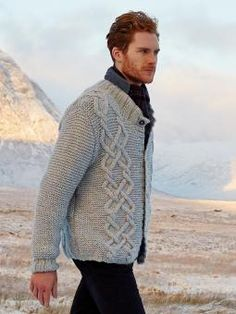 Fyn - Knit this mens cable and garter stitch cardigan from Rowan Knitting and Crochet Magazine 56, a design by Marie Wallin using the luxurious Cocoon (Merino Wool and Kid Mohair). With set-in sleeves, cabled panels and stand up collar, this knitting pattern is for the intermediate knitter.
