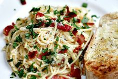 Spaghetti Carbonara with Artichokes and Sun-dried Tomatoes | Tasty Kitchen: A Happy Recipe Community!  Just added more artichokes  Very good!!