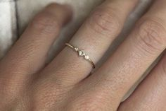 Unique dainty and sparkly diamond ring. Tiny but still prominent. Item info: Gemstone: Diamond Total carat weight: 0.06carat Gemstone Quality: