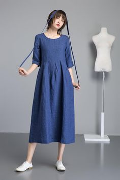 bb5a6bfd6b90 DETAILS  The blue linen dress is made of linen blend. The long linen dress