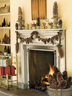 Brawny sugar pinecone swags anchor a mixed-cone garland above the fireplace. Make it yourself with a variable-speed drill and braided picture-hanger wire. Place inverted cones in urns to create quick-and-easy pinecone topiaries.