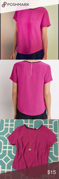Fuchsia Top With Front Pocket Beautiful, gently used (once) fuchsia top with dark navy neck trim, front pocket, and zipper on the back. Great condition and lovely eye catching color! Forever 21 Tops Blouses