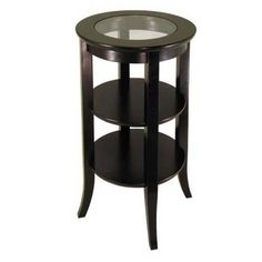 certainly too high for your purpose or could it work? http://www.ebay.com/itm/Round-Dark-Wood-Accent-Table-w-Glass-Inset-2-Shelves-/390477740811?forcev4exp=true=true#ht_1017wt_1178 ebay $86.05