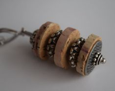 Wine Cork Pendant with Silver Accents is part of Cork crafts Necklace - 4 Chain Length 30 Thank you for visiting Shimmer's Etsy Shop Cheers! Wine Cork Jewelry, Wine Cork Art, Bottle Jewelry, Wine Cork Crafts, Bottle Crafts, Recycled Wine Corks, Recycled Jewelry, Wire Crafts, Jewelry Crafts