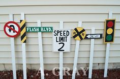 DIY Handmade race car themed birthday party road sign decor. No U Turn, Construction, Street Sign, Speed Limit, Railroad Crossing, One Way, and Traffic Light.
