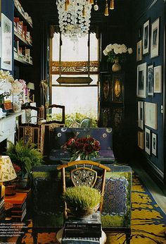 Muriel Brandolino's study walls coated in indigo corduroy fabric. Banquet sofas upholstered in vintage fabrics.