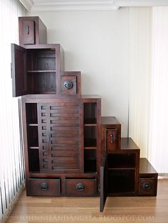 Stair step cabinet:  officially called a Japanese Tansu Step Chest. Can be rearranged (click through for pictures) into a pyramid or square.