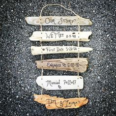 Our Love Story custom sign with dates includes up to 7 individual driftwood signs strung together and hand engraved with custom words and dates to tell your story. (For more than 7 signs, please request a custom order). Each sign is hand engraved and all signs are strung together with