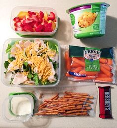 Fresh strawberry and peach slices, romaine salad with chicken slices, shredded cheddar, and Brianna's ranch. Pretzel sticks, baby carrots, mini dark chocolate Hershey bar, and Simple Truth Organic shells and cheese.