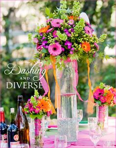 Long stem bouquets...wrap stems with ribbon and place in tall cylindrical vases.  REAL WEDDINGS: Dashing & Diverse