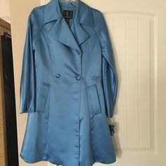Blue satin coat NWT blue satin coat with rhinestone belt (as seen in pic 2). The buckle is wrapped in tissue so it won't pick the satin. All rhinestones are intact. Matching skirt listed separately. No holes, stains, etc INC International Concepts Jackets & Coats