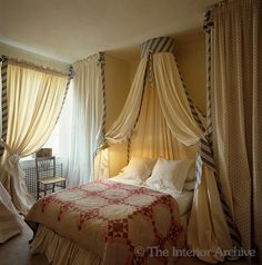 Mimmi O'Connell ~ The use of curtains and drapes add drama and a sense of luxury to this bedroom in London
