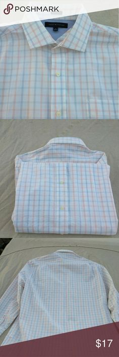 TOMMY HILFIGER MEN DRESS SHIRT This everyday go- to from Tommy Hilfiger features a versatile solid hue and a classic fit for a loose, relaxed feel. Product features: *A classic fit offers generous cut throughout the chest and waist for overall ease, features standard armholes and Fuller sleeves. * Non- iron * Button- down collar * Button cuffs * Cotton * Machine washable Tommy Hilfiger Shirts Dress Shirts