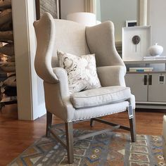 Alice Lane Home Collection   Linen wingback chair with Rebecca Atwood marble pillow.