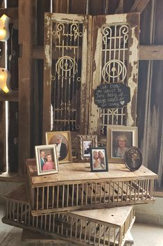 Antique white doors and photos on top of antique chicken cages