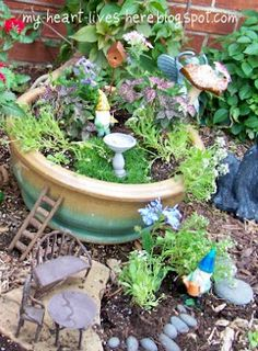 I soooo want a fairy garden to welcome spring now!  New annual tradition!  :)