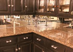 Mirror backsplash to open up kitchen. It will look as if there is another room behind cabinets. If you have under cabinet lighting the mirror will reflect the light. cooooll
