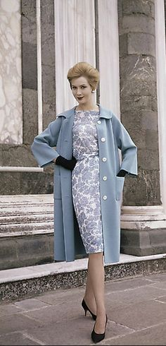 1960 An afternoon dress of white silk jersey with blue flowers, to be worn with an overcoat of blue woolen jersey with two big pockets. It is a creation by the Mirsa fashion house of Rome and Milan and was presented at the big show of Italian autumn and winter fashions in the Pitti Palace in Florence,