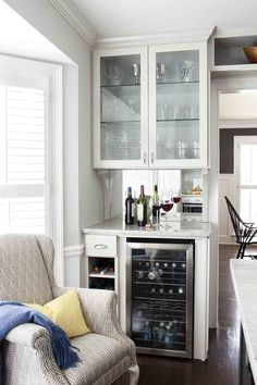 Country Bar With Chair Rail Mirror Backsplash Glass Cabinet Doors Upholstered Wingback